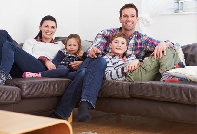 young family enjoying heat pump warmth
