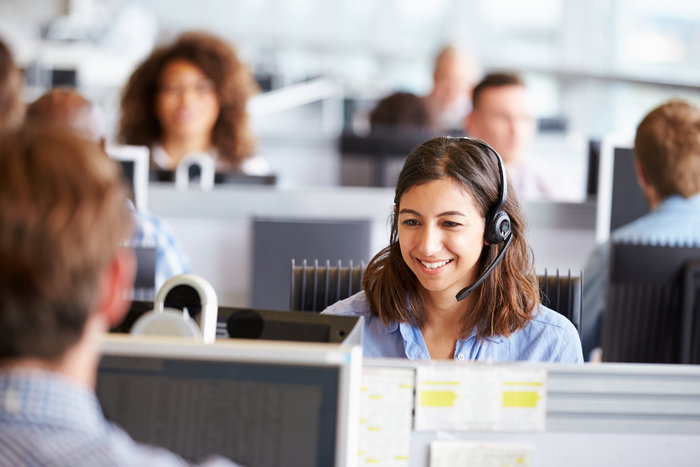 Young woman in happy work environment