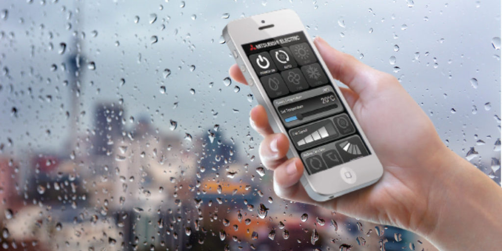 wifi control in hand, rainy Auckland, wifi heat pumps auckland